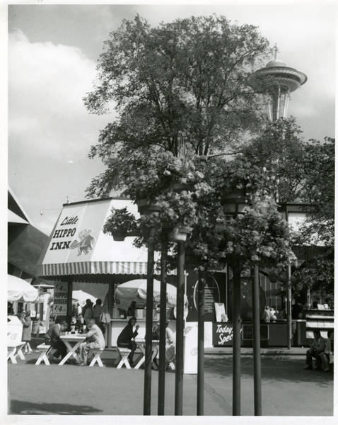 View east of plaza south of Coliseum with Space Needle