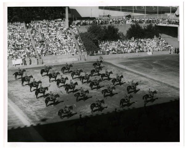 Canadian military tatoo [i.e. tattoo] in stadium: Northwest mounted police on parade; View N.E.