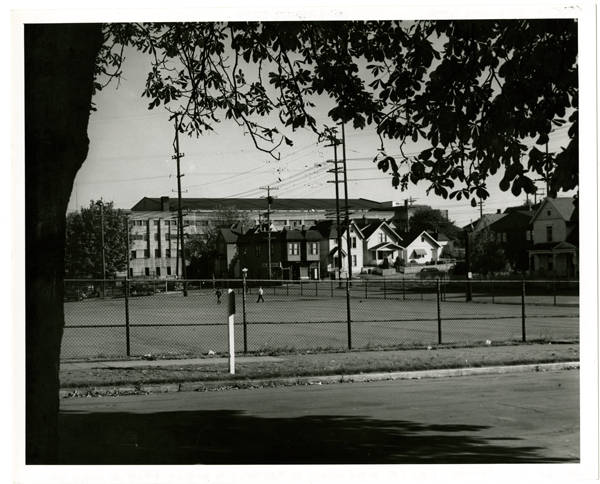 View S.E. across corner of playfield to 300 block 2nd Ave. No. & Field Armory
