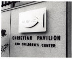 At entrance to Christian Witness Pavilion