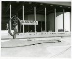 Canadian exhibit north of Coliseum; pool with fountain foreg.
