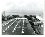 View west across roof of Commerce & Industry Pavilion; Canadian ships in Elliott Bay