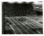 Stadium; Police drill team in closing day ceremony; Color guard to right