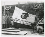 World's Fair flag: From left to right Lt. Gov. John A. Cherberg; Mayor [sic] (then) Councilman...