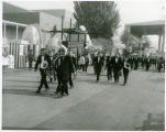Musicians from Sortland Music Corp [i.e. Corps]; Norway on way to concert in band shell;...